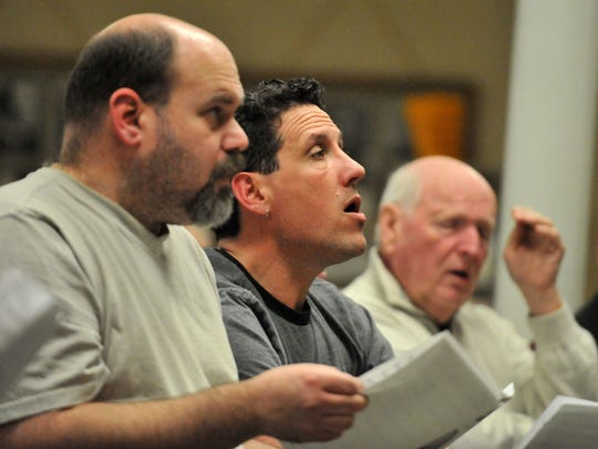 Todd Barstow, left, and Jason Boch, center, rehearse with the Lancaster Men's Chorus March 30 at St. Peter Lutheran Church in Lancaster.