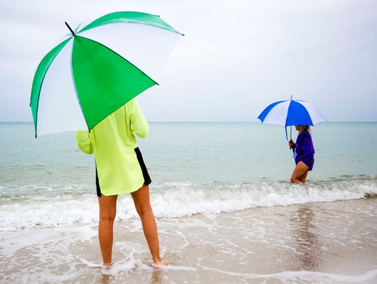 Vacationers wait for the rain to stop on Saturday,