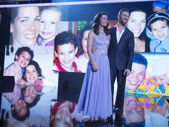 "Former Olympic figure skater Nancy Kerrigan is pictured with her dance partner Artem Chigvintsev as photos of Kerrigan with her children appear during a segment in ""Dancing With The Stars."""