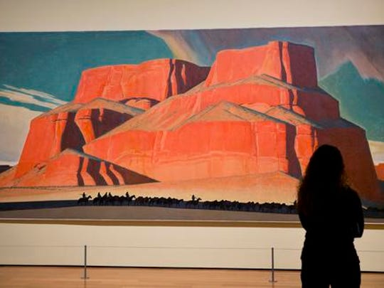 """In this Monday, Feb. 6, 2017 photo, Maynard Dixon's 1935 painting """"Red Butte with Mountain Men"""" is displayed in the exhibit """"Cross Country: The Power of Place in American Art, 1915-1950,"""" at the High Museum of Art in Atlanta. The new exhibition at takes a look at how American artists during the modernist period traveled outside cities to find inspiration in the rural landscape."""