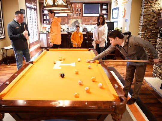 Butch Jones plays pool with his sons Alex, Adam, and Andrew as Barb looks on Thursday Dec. 22, 2016, in Knoxville, Tenn.