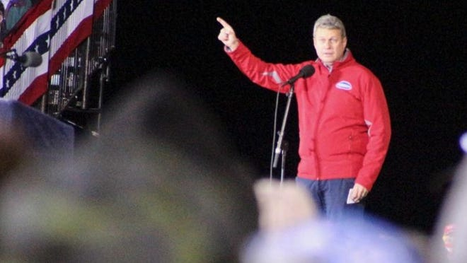 U.S. Rep. Bill Huizenga, R-Zeeland, addresses the crowd of President Trump supporters prior to the president's arrival Monday, Nov. 2, at Gerald R. Ford International Airport in Grand Rapids.