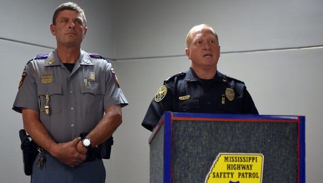 Hattiesburg Police Department spokesman Lt. Jon Traxler, right, speaks with and Mississippi Highway Patrol Troop J spokesman Brent Barfield about the increase in roadblocks on the upcoming weeks.