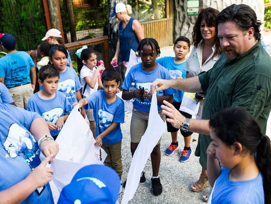 Luke Dollar interacts with students from the Everglades