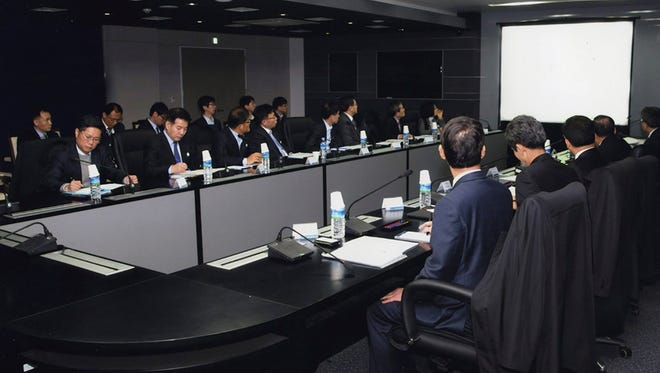 A handout picture released by South Korea's National Intelligence Service (NIS) shows representatives of 14 government agencies holding an emergency meeting at the spy agency's building in Seoul, South Korea, March 8, 2016, to discuss countermeasures against North Korea's attempt to hack into the smartphones of key South Korean officials.