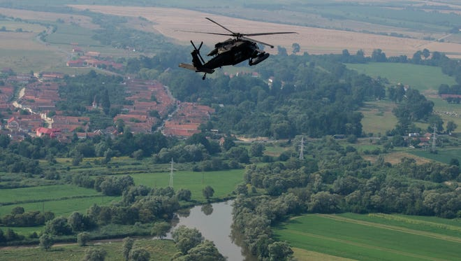 A UH-60 Black Hawk with Charlie Company, 3-501st performs flight maneuvers near the town of Voila, Romania, during the Saber Guardian exercise. Saber Guardian is a multinational exercise involving about 2,800 troops from 10 nations, including the United States.