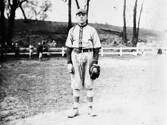 An old photograph of a baseball player at Virginia School for the Deaf and the Blind.