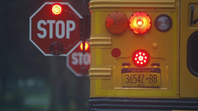 A school bus stops on Bonnie Brae Avenue in Brighton to pick up a student for Council Rock Primary School.