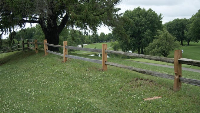 The site of the crushed fence, east of North Randolph Street on University Drive, is reconstructed with fresh posts to hold the original horizontal boards in place. The repairs cost the Country Club and estimated $500.