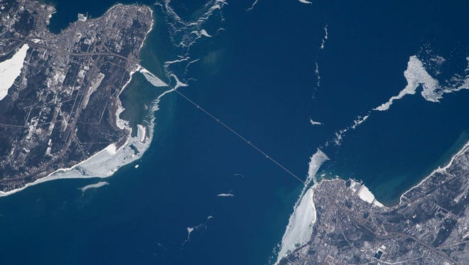 The Mackinac Bridge from the International Space Station on April 18, 2018. St. Ignace is at the top of the photo and Mackinaw City is at the bottom