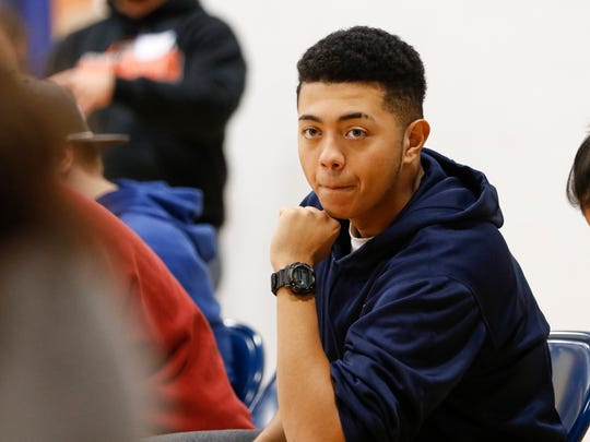 Appleton West High School junior Isaiah Donaldson listens to one of peers during the Sources of Strength training session at the Boys and Girls Club of the Fox Valley Thursday, Nov. 9, 2017, in Appleton, Wis.