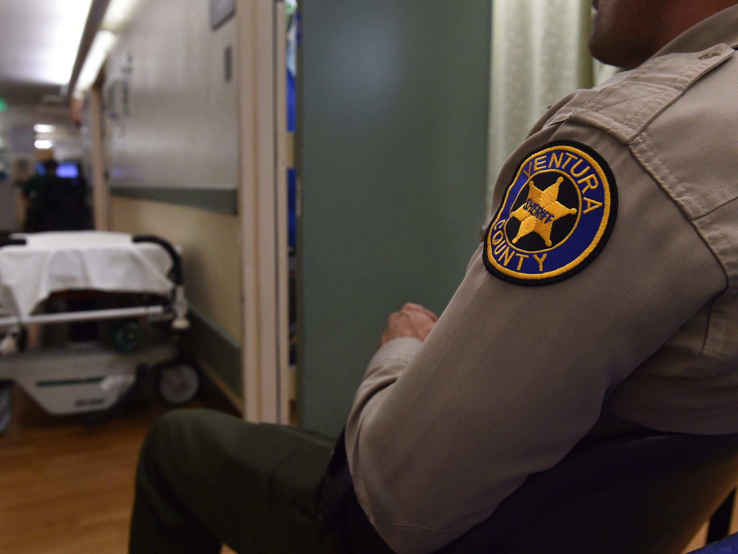 A Ventura County Sheriff's Office deputy watches over