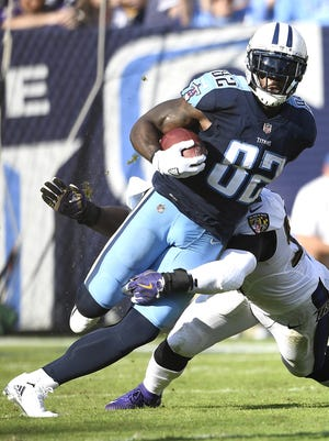 #82, Delanie Walker, Tight End: Titans tight end Delanie Walker (82) races up the field with a completion during the third quarter at Nissan Stadium Sunday, Nov. 5, 2017 in Nashville, Tenn.