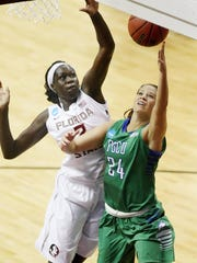 photos by KINFAY MOROTI/THE NEWS-PRESSFlorida State University's Adut Bulgak blocks the shot of FGCU's Taylor Gradinjan during Monday's NCAA Tournament game at the Donald L. Tucker Civic Center in Tallahassee. Taylor was FGCU's top scorer with 12 points as FSU beat FGCU 65-47. KINFAY MOROTI/THE NEWS-PRESS ... Florida State University's Adut Bulgak, left, blocks the shot of FGCU's Taylor Gradinjan on Monday at the Donald L. Tucker Civic Center in Tallahhassee. Taylor was FGCU's top scorer with 12 points. FSU beat FGCU 65-47 in the NCAA tournament.