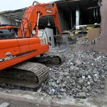 IKEA store in Canton started demolition of building next door to them that used to house an ABC Warehouse on Tuesday, Sept. 29, 2014, to make room for a 44,000 square foot expansion to better service their growing customer base.