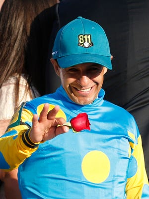 Kentucky Derby-winning jockey Victor Espinoza acknowledges the crowd after securing his third Kentucky Derby win. May 2, 2015