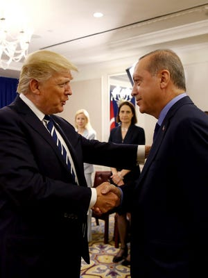 Turkey's President Recep Tayyip Erdogan, right, and U.S. President Donald Trump shake hands at the beginning of their meeting in New York, Sept. 21. Trump raised the issue of Turkey's imprisonment of Andrew Brunson, a Christian missionary from Black Mountain.