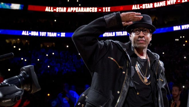 Former Philadelphia 76ers star Allen Iverson salutes the crowd during a retirement ceremony March 1, 2014, in Philadelphia.