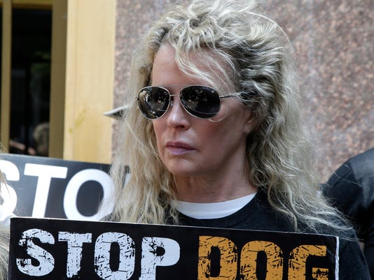 Priscilla Presley, Kim Basinger protest dog-meat trade by holding actual dead dogs