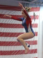 Wappingers' Olivia Frederick performs on the balance