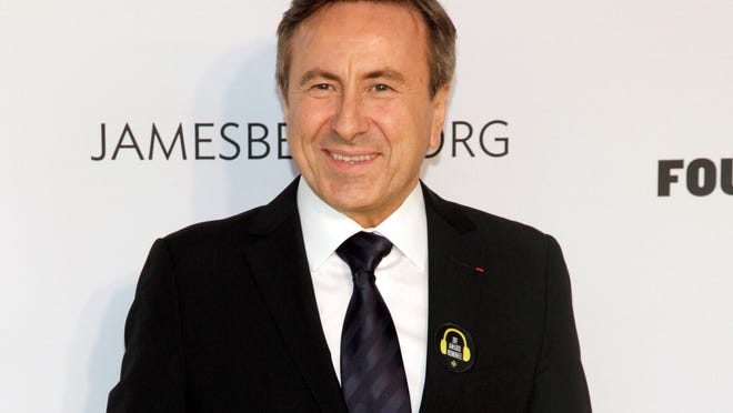 In this May 5, 2014 file photo shows restauranteur Daniel Boulud at the 2014 James Beard Foundation Awards in New York. The Michelin Guide's latest roster of top New York City restaurants says Brooklyn and Queens are hot, but Daniel Boulud is not. This year, only six maintained the three-star rating for the guide's 10th edition, which goes on sale Wednesday. Daniel Boulud's flagship Upper East Side restaurant, was bumped down to two stars.