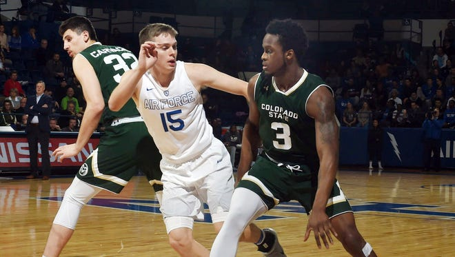Air Force guard Jacob Van defends against Colorado State guard Raquan Mitchell during the first half of an NCAA college basketball game Tuesday, Feb. 6, 2018, at Air Force Academy, Colo. Air Force won 78-73. (Jerilee Bennett/The Gazette via AP)