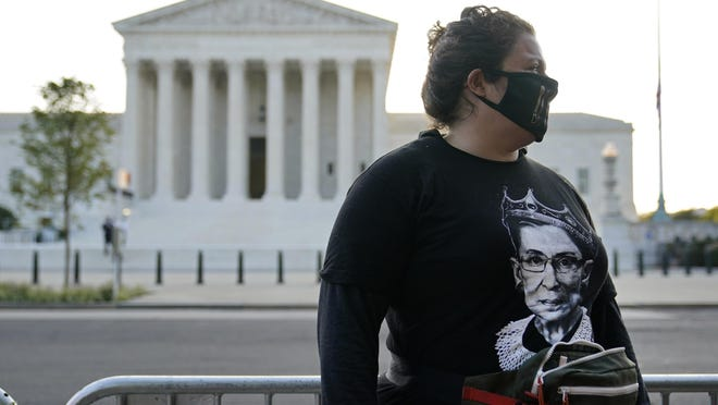 Kara Stewart of Martin, Ky., stands outside the Supreme Court in Washington, Wednesday, Sept. 23, 2020, before a private ceremony and public viewing of Justice Ruth Bader Ginsburg. Ginsburg, 87, died of cancer on Sept. 18.