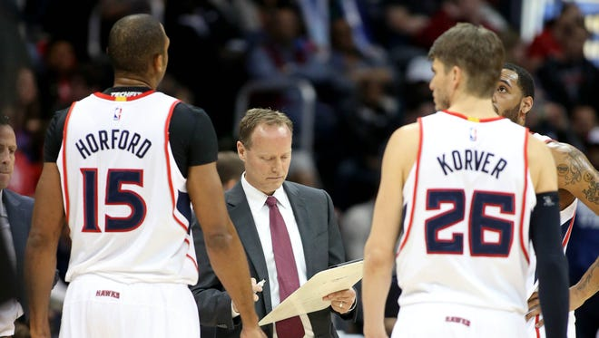 Hawks coach Mike Budenholzer isn't defined by his excellence with X's and O's.
