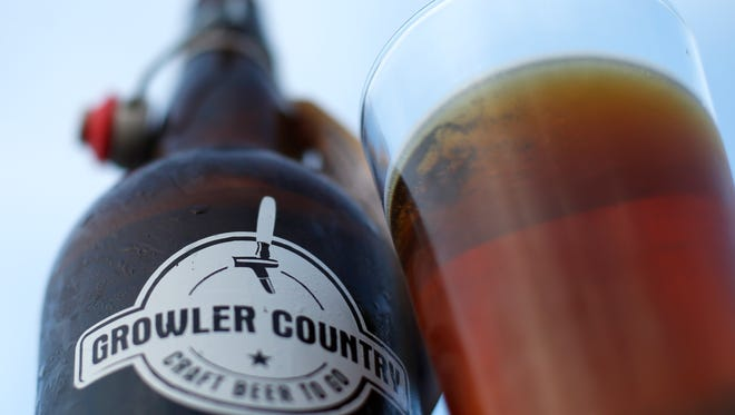 A 32-ounce beer from Growler Country, sold to-go at the craft beer market.