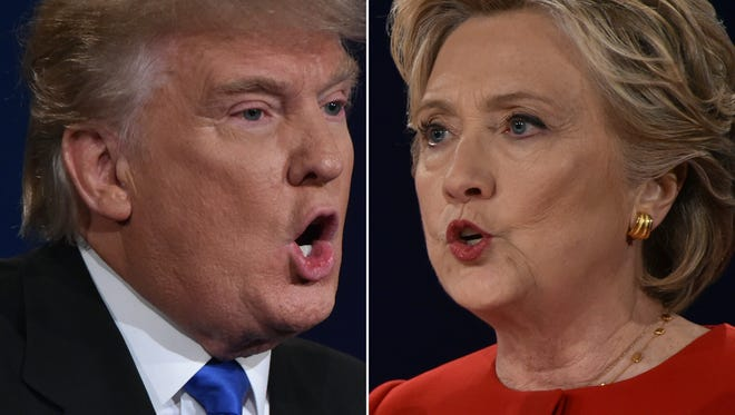 In this Combination of pictures taken on September 26, 2016, Republican nominee Donald Trump and Democratic nominee Hillary Clinton face off during the first presidential debate at Hofstra University in Hempstead, New York. / AFP / Paul J. Richards