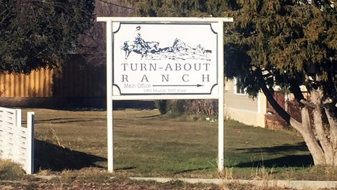 This Dec. 6, 2016, photo shows a sign for Turn-About Ranch near Escalante, Utah.