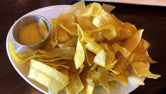 """Mariquitas, thinly-sliced plantains, fried until """"golden and crunchy"""" and served with garlic sauce for dipping, at Fernandez the Bull."""