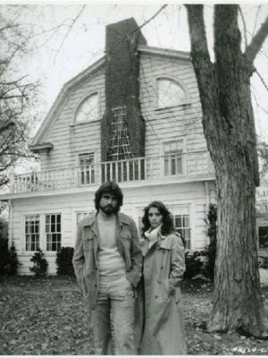 """A 1979 publicity still of James Brolin and Margot Kidder outside the Dutch Colonial house at 18 Brooks Road in Toms River, where the original """"The Amityville Horror"""" was filmed."""
