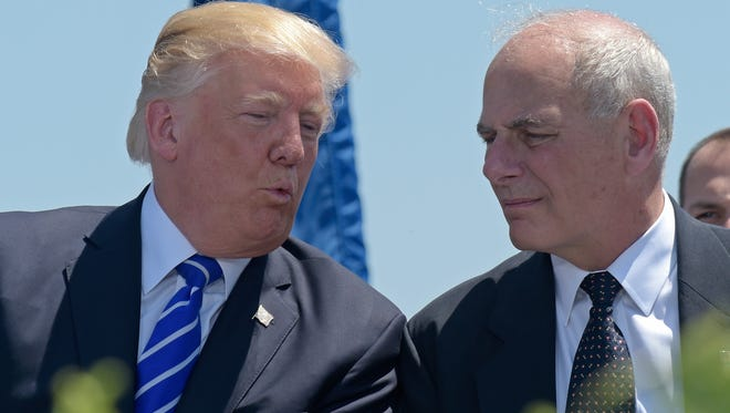 President Trump talks with Homeland Security Secretary John Kelly during commencement exercises at the U.S. Coast Guard Academy in New London, Conn., on May 17, 2017.