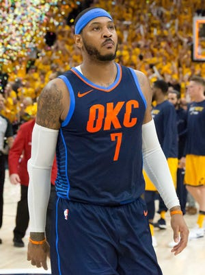 Oklahoma City Thunder forward Carmelo Anthony walks off the court after losing Game 6 against the Utah Jazz.
