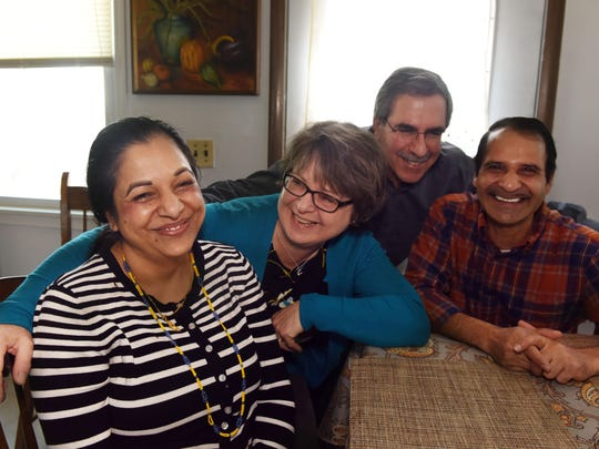"Abi and Mon Maya Chamaglai of Burlington host Jan and Bob Battaline of Essex Junction at their home in Burlington on Thursday, February 23, 2017. The Battalines are volunteer ""family friends"" for the USCRI Vermont Refugee Resettlement Program. Family friends help refugees assimilate into their respective communities. The Chamaglais came to the U.S. in 2008, from Nepal, where they had resided in a refugee camp for 17 years. They met and wed in the camp. They are originally from Bhutan."