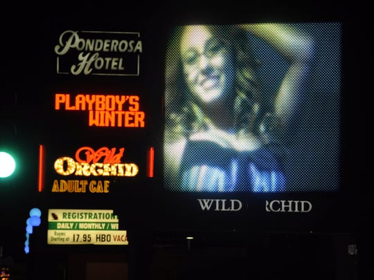 The video sign outside the Wild Orchid gentleman's club at the north end of Reno's Midtown is one of the area's most criticized digital signs.