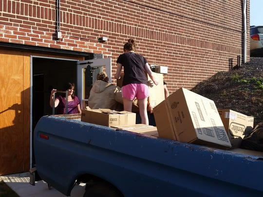 Chase Hartman's helpers deliver a truck bed full of