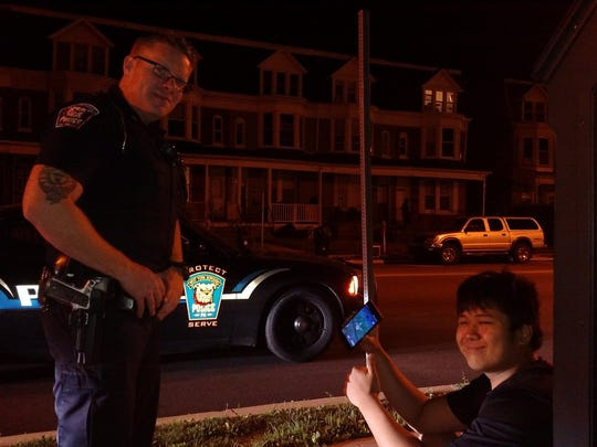 West York Police Officer Scott Musselman urges a Pokemon