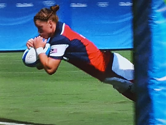 In this screenshot, Alev Kelter is diving for a try during a match in the Rio Olympics.