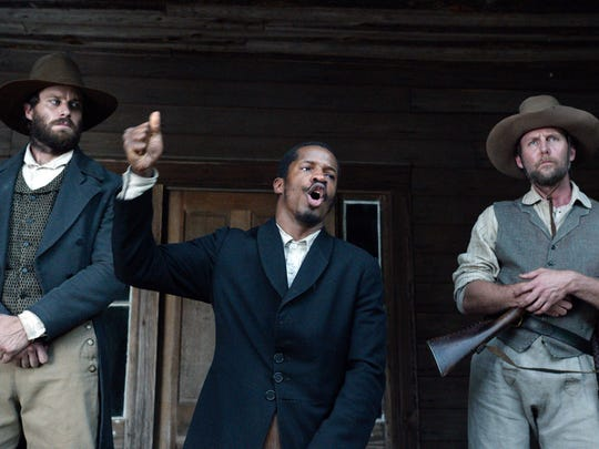 """In this image released by Fox Searchlight Pictures, from left, Armie Hammer portrays Samuel Turner, Nate Parker portrays Nat Turner and Jayson Warner Smith portrays Earl Fowler in a scene from """"The Birth of a Nation."""""""