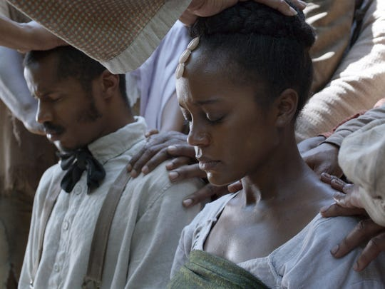 """Nate Parker as Nat Turner, left, and Aja Naomi King as Cherry in a scene from """"The Birth of a Nation."""""""