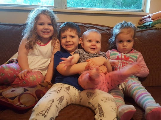 Joshua and Jamie Docter of Pineville have four kids - Maggie, 4; Liam, 6; Emma, 9 months; and Riley, 3.