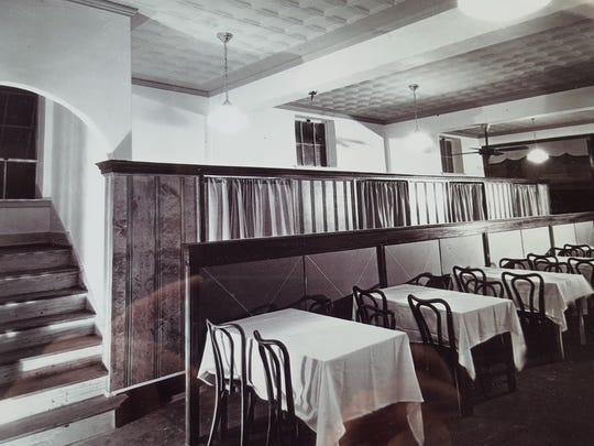 A photo of the interior of Charlie's Steak House shows  what the restaurant once looked like.
