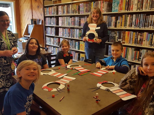 Each of the three Madison County Public Libraries scheduled special Dr. Seuss-related events and readings for second-graders throughout the week. Here, students show off their Cat in the Hat creations alongside Hot Springs Elementary School and Library educators.