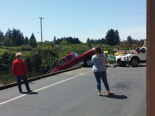 A pickup truck jumped the safety cable at Stayton Pharmacy and landed in an adjacent pond. No injuries were reported.