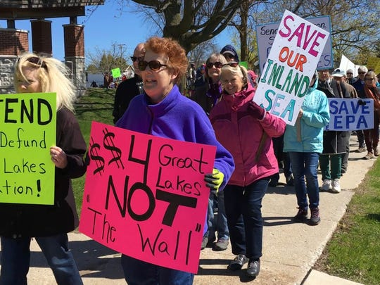 About 150 people participated Saturday in Sturgeon Bay to protest proposed cuts to budgets funding protection and clean-up of Great Lakes.