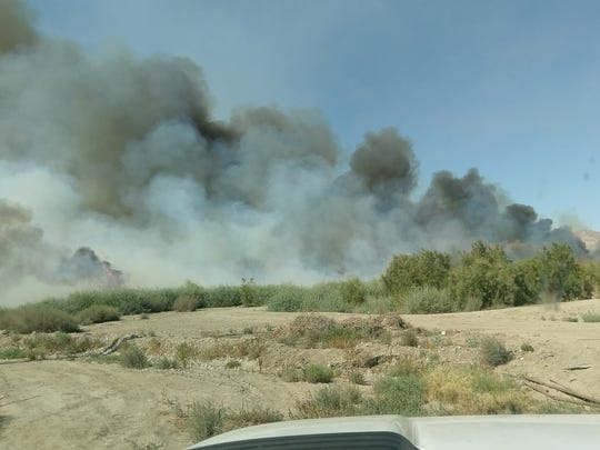 Firefighters were battling a brush fire in Mecca Sunday.
