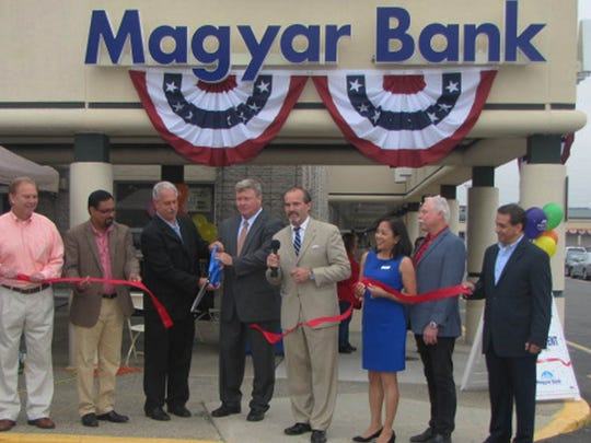 Many local dignitaries were on hand June 17 to welcome Magyar Bank's second Edison branch, in Tano Mall. Those attending included, from left, Lina Lona, executive director, Middlesex County Regional Chamber of Commerce;Robert Diehl, Edison council member;Ajay Patil, Edison council member;Tom Lankey, mayor of Edison;John Fitzgerald, president & CEO, Magyar Bank;Joe Coyle, executive director, Edison Chamber of Commerce, Joeclyn Valenzuela, vice president, branch manager, Magyar Bank;Rob Karabinchak, assemblyman, 18th District; and Jay Castillo, senior vice president, chief retail officer, Magyar Bank.