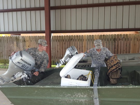 Louisiana National Guard Cadet Hunter Fontenot and Spc. Jason Albritton, of 769th Brigade Engineer Battalion, 256th Infantry Brigade Combat Team, inspect boats ahead of the possible response to Tropical Storm Cindy. More than 80 high-water vehicles and 33 boats have been staged in 14 parishes.